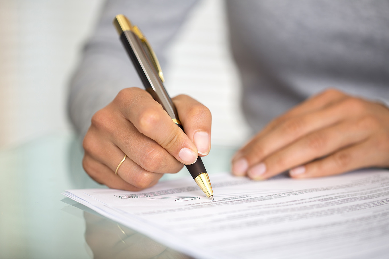 Person filling out paperwork.